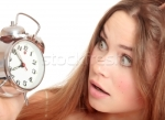 511708_stock-photo-unhappy-girl-waking-up-too-late-and-looking-at-the-alarm-clock